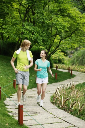 Man and woman jogging in the park photo