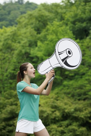 Woman speaking through megaphone photo