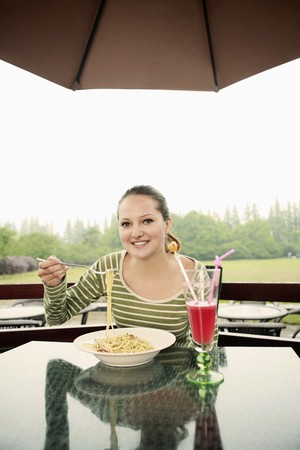 Woman with a plate of pasta Stock Photo - 7834583