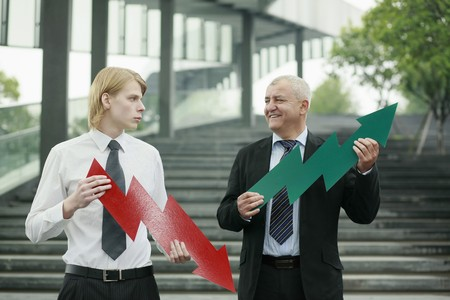 Businessmen with arrow signs photo