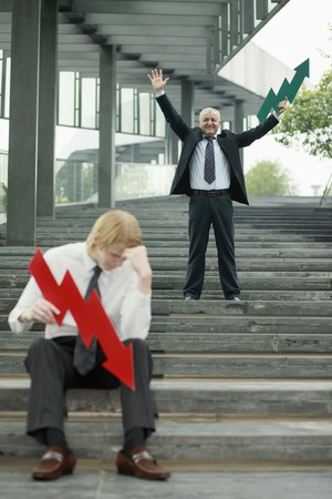 Businessmen with arrow signs Stock Photo - 7834378