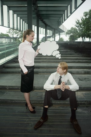 Businesswoman holding thinking bubble above businessman's head Stock Photo - 7834862