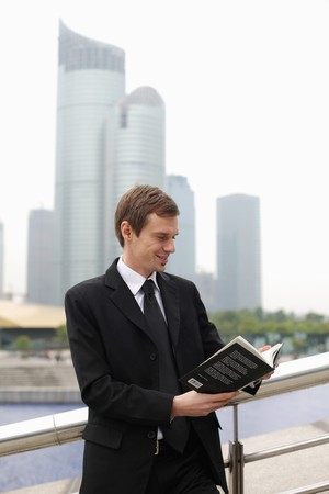 Businessman reading a book photo
