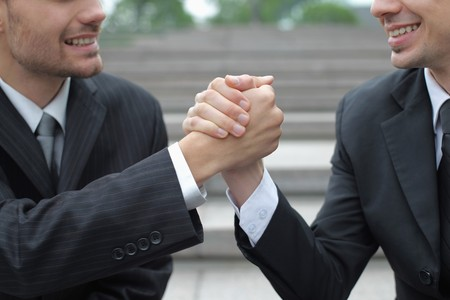 Businessmen with arms clasped photo