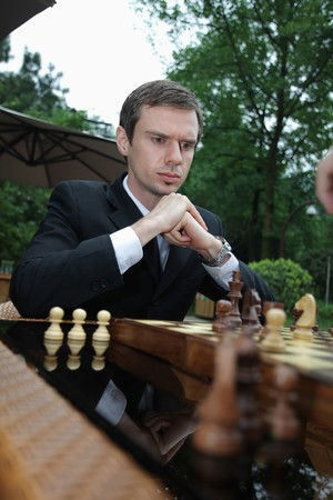 scandinavian descent: Businessmen playing chess outdoors Stock Photo