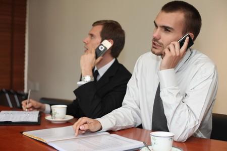 scandinavian descent: Businessmen talking on the phone Stock Photo