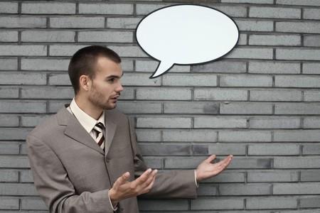 Businessman with speech bubble photo