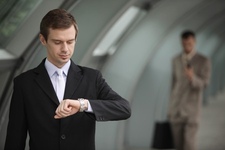 Businessman looking at his watch photo