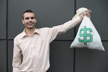 Businessman holding money bag photo