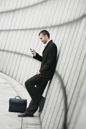 Businessman text messaging Stock Photo - 7835589