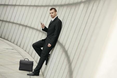 Businessman text messaging Stock Photo - 7834931