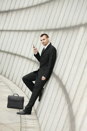 Businessman text messaging photo