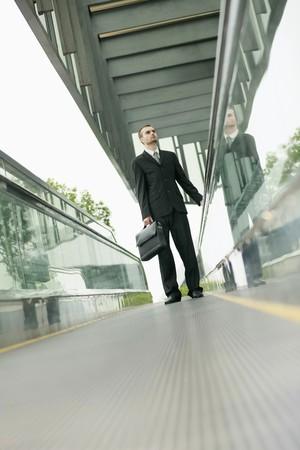 Businessman on escalator photo