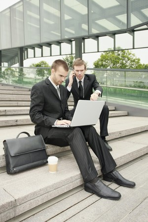Businessmen working outdoors photo