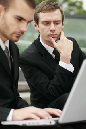 scandinavian descent: Businessmen working outdoors Stock Photo
