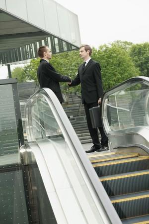 scandinavian descent: Businessmen shaking hands