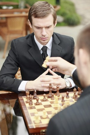 Businessmen playing chess outdoors Stock Photo - 7835027