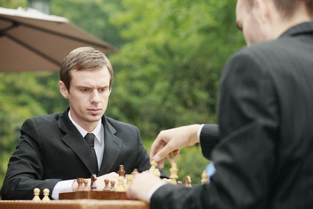 Businessmen playing chess outdoors Stock Photo - 7834515
