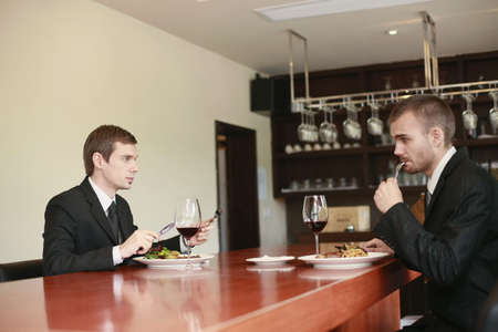 Businessmen having meal at a restaurant photo