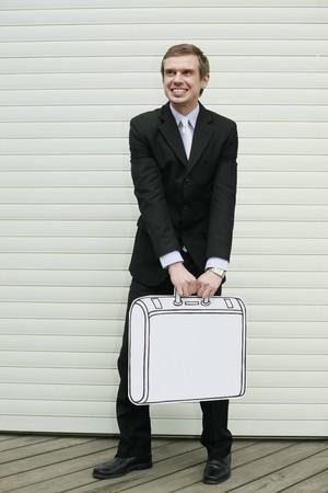 Businessman holding briefcase photo