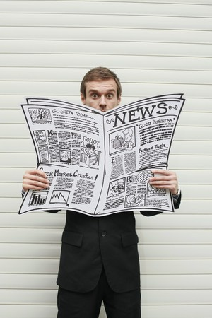 reading material: Businessman reading newspaper