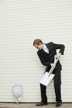 Businessman holding a shovel Stock Photo - 7834849