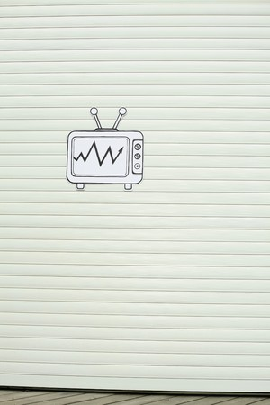 Cardboard television on wooden wall photo