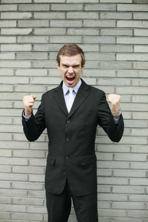 clenching fists: Businessman shouting and clenching fists Stock Photo