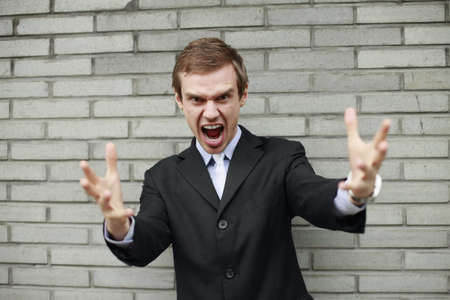 mouth opened: Businessman with mouth opened and hand gestures