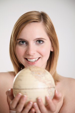 Woman with globe in her hands photo