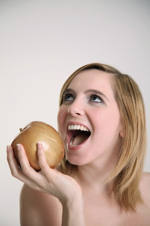 Woman about to eat a golden apple Stock Photo - 7834405