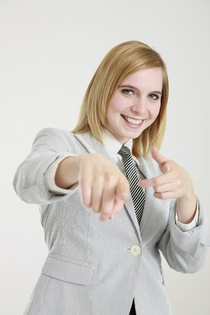 Businesswoman pointing finger photo