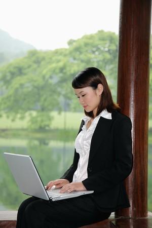 Businesswoman using laptop Stock Photo - 7839284
