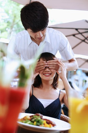 Man covering woman's eyes with hands Stock Photo - 7839249