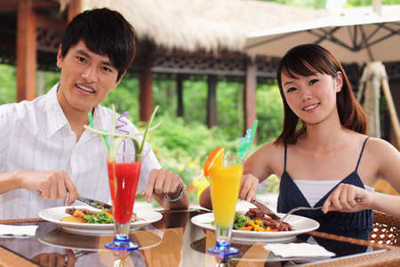 Man and woman enjoying their meal outdoor Stock Photo - 24303657