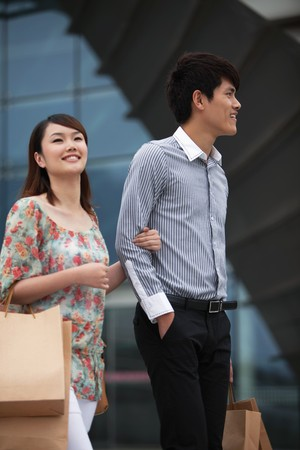 Man and woman with shopping bags Stock Photo - 7839305