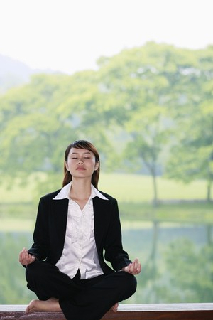 Businesswoman meditating photo