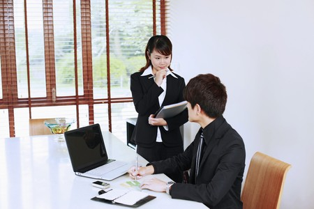 Businessman and his secretary photo