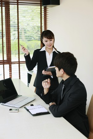 Businessman and his secretary Stock Photo - 7839308
