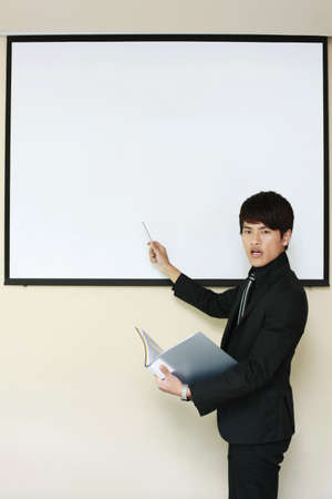 Businessman giving presentation photo