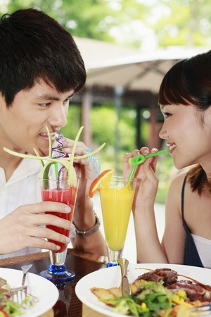 Man and woman enjoying their drinks photo