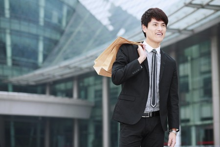Businessman with shopping bags photo