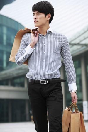 Man carrying shopping bags photo
