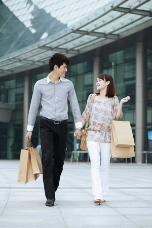 Man and woman with shopping bags Stock Photo - 7839437