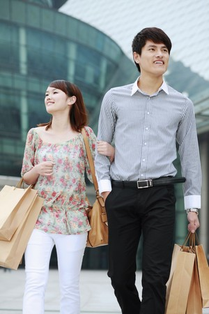 Man and woman with shopping bags Stock Photo - 7839425