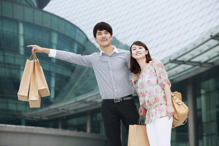 stopping: Man and woman hailing a cab Stock Photo