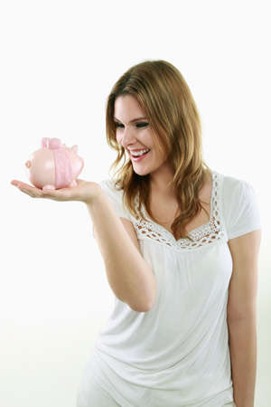 casua: Woman holding a piggy bank Stock Photo