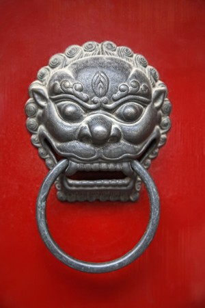 Knocker on traditional chinese door Stock Photo - 8018595