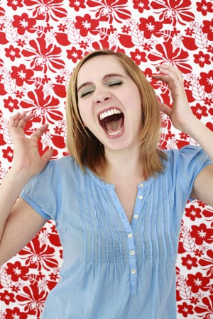 Woman screaming with eyes closed photo