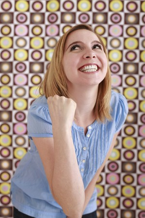 Woman smiling and cheering photo